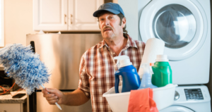 man with cleaning materials